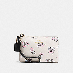 COACH CORNER ZIP WRISTLET IN WILDFLOWER PRINT COATED CANVAS - IMITATION GOLD/CHALK MULTI - F65188