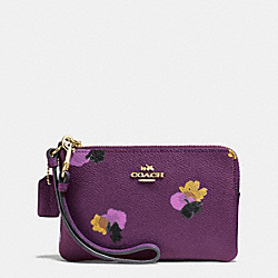 COACH CORNER ZIP WRISTLET IN FLORAL PRINT COATED CANVAS - LIGHT GOLD/PLUM MULTI - F65307
