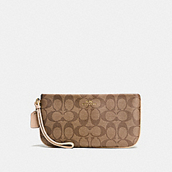 COACH LARGE WRISTLET IN SIGNATURE - IMITATION GOLD/KHAKI PLATINUM - F65748