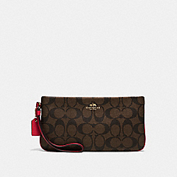 COACH LARGE WRISTLET IN SIGNATURE - IMITATION GOLD/BROWN TRUE RED - F65748