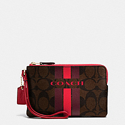 COACH COACH VARSITY STRIPE CORNER ZIP WRISTLET IN SIGNATURE - IMITATION GOLD/BROW TRUE RED - F66052