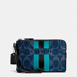 COACH COACH VARSITY STRIPE CORNER ZIP WRISTLET IN SIGNATURE - SILVER/DENIM/BLACK - F66052