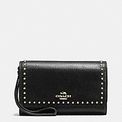 COACH RIVETS PHONE WRISTLET IN GRAIN LEATHER - IMITATION GOLD/BLACK - F66194