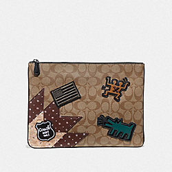 KEITH HARING LARGE POUCH IN SIGNATURE CANVAS WITH PATCHES - KHAKI/MULTI/BLACK ANTIQUE NICKEL - COACH F66585