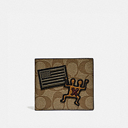 KEITH HARING DOUBLE BILLFOLD WALLET IN SIGNATURE CANVAS WITH PATCHES - KHAKI/MULTI/BLACK ANTIQUE NICKEL - COACH F66591