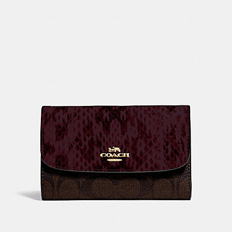 COACH MEDIUM ENVELOPE WALLET IN SIGNATURE CANVAS - BROWN BLACK/MULTI/IMITATION GOLD - F67498