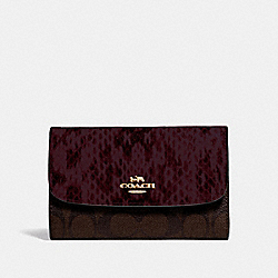 MEDIUM ENVELOPE WALLET IN SIGNATURE CANVAS - BROWN BLACK/MULTI/IMITATION GOLD - COACH F67498