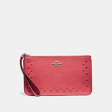COACH LARGE WRISTLET WITH STUDS - CORAL/SILVER - F67501