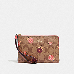 CORNER ZIP WRISTLET IN SIGNATURE CANVAS WITH TOSSED PEONY PRINT - KHAKI/PINK MULTI/IMITATION GOLD - COACH F67535
