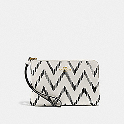 CORNER ZIP WRISTLET WITH GEO CHEVRON PRINT - BLACK/CHALK/IMITATION GOLD - COACH F67553