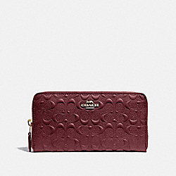ACCORDION ZIP WALLET IN SIGNATURE LEATHER - WINE/IMITATION GOLD - COACH F67566