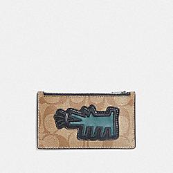 KEITH HARING ZIP CARD CASE IN SIGNATURE CANVAS WITH MOTIF - KHAKI/MULTI/BLACK ANTIQUE NICKEL - COACH F68470