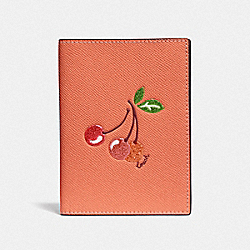 PASSPORT CASE WITH CHERRY - LIGHT CORAL/GOLD - COACH F68621