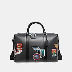 VOYAGER BAG WITH TRAVEL PATCHES - MIDNIGHT NAVY/MULTI - COACH F72944