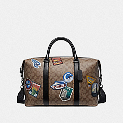 VOYAGER BAG IN SIGNATURE CANVAS WITH TRAVEL PATCHES - TAN - COACH F72948