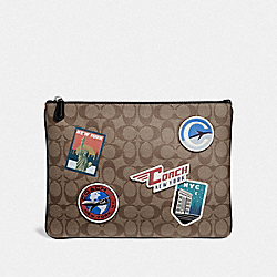 LARGE POUCH IN SIGNATURE CANVAS WITH TRAVEL PATCHES - KHAKI/MULTI - COACH F73075
