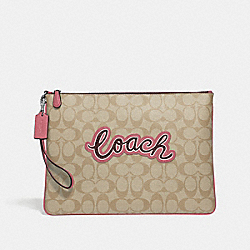 LARGE WRISTLET 30 IN SIGNATURE CANVAS WITH COACH PRINT - LIGHT KHAKI MULTI/SILVER - COACH F73153