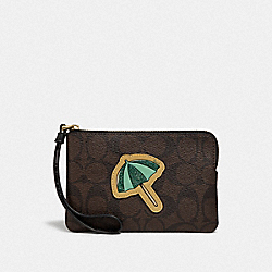 CORNER ZIP WRISTLET IN SIGNATURE CANVAS WITH MOTIF - BROWN BLACK/GOLD - COACH F73584