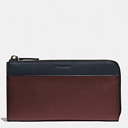COACH BLEECKER LARGE HALF ZIP WALLET IN LEATHER - CORDOVAN/NAVY - F74626