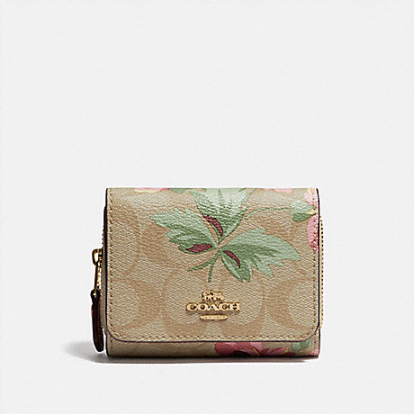 COACH SMALL TRIFOLD WALLET IN SIGNATURE CANVAS WITH LILY PRINT - LIGHT KHAKI/PINK MULTI/IMITATION GOLD - F75922