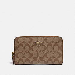 CONTINENTAL ZIP AROUND WALLET IN SIGNATURE CANVAS - KHAKI/SADDLE 2/GOLD - COACH F76579
