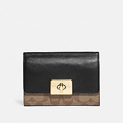CASSIDY TURNLOCK MEDIUM WALLET IN SIGNATURE CANVAS - IM/KHAKI/BLACK - COACH F76789