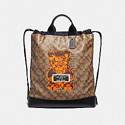 TERRAIN DRAWSTRING BACKPACK IN SIGNATURE CANVAS WITH VANDAL GUMMY - TAN/BLACK ANTIQUE NICKEL - COACH F76805
