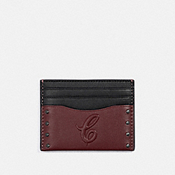 SLIM CARD CASE WITH SIGNATURE MOTIF AND STUDS - QB/CURRANT - COACH F76967