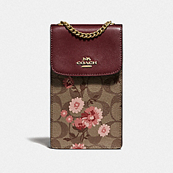 NORTH/SOUTH PHONE CROSSBODY IN SIGNATURE CANVAS WITH PRAIRIE DAISY CLUSTER PRINT - KHAKI CORAL MULTI/IMITATION GOLD - COACH F76988