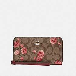 LARGE PHONE WALLET IN SIGNATURE CANVAS WITH PRAIRIE DAISY CLUSTER PRINT - KHAKI CORAL MULTI/IMITATION GOLD - COACH F78021