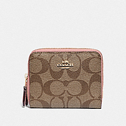 SMALL DOUBLE ZIP AROUND WALLET IN BLOCKED SIGNATURE CANVAS - IM/KHAKI PINK PETAL - COACH F78079