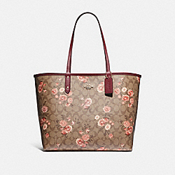 REVERSIBLE CITY TOTE IN SIGNATURE CANVAS WITH PRAIRIE DAISY CLUSTER PRINT - KHAKI CORAL MULTI/WINE/IMITATION GOLD - COACH F78279