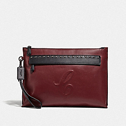 CARRYALL POUCH WITH SIGNATURE MOTIF AND STUDS - QB/CURRANT - COACH F78836