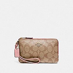 DOUBLE CORNER ZIP WRISTLET IN SIGNATURE CANVAS - IM/KHAKI PINK PETAL - COACH F87591