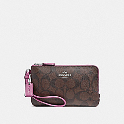 DOUBLE CORNER ZIP WRISTLET IN SIGNATURE CANVAS - BROWN/AZALEA/SILVER - COACH F87591