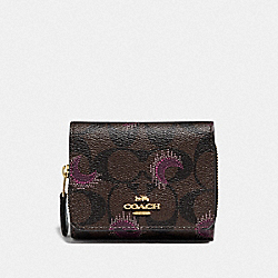 SMALL TRIFOLD WALLET IN SIGNATURE CANVAS WITH MOON PRINT - IM/BROWN PURPLE MULTI - COACH F87758