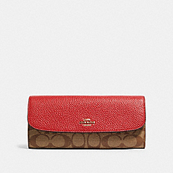 LUNAR NEW YEAR SOFT WALLET IN COLORBLOCK SIGNATURE CANVAS WITH RAT - IM/TRUE RED MULTI - COACH F88100