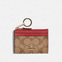MINI SKINNY ID CASE IN COLORBLOCK SIGNATURE CANVAS - IM/TRUE RED MULTI - COACH F88585