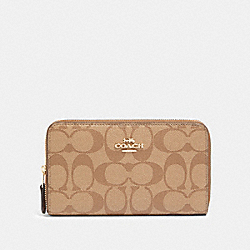 MEDIUM ZIP AROUND WALLET IN SIGNATURE CANVAS - IM/KHAKI/SADDLE 2 - COACH F88913