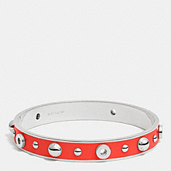 ENAMEL GROMMETS AND RIVETS BANGLE - SILVER/ORANGE - COACH F90512