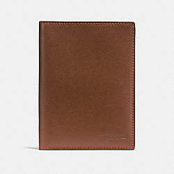 COACH PASSPORT CASE IN CALF LEATHER - DARK SADDLE - F93604