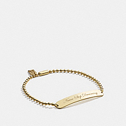 NEVER STOP DREAMING BRACELET - GOLD - COACH F99677