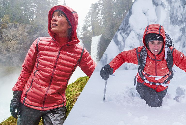 A man and woman in rain /snow wearing the Turbodown OutDry Extreme Gold Down jacket