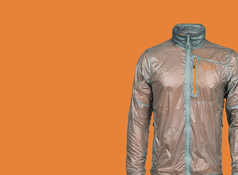 The Ghost Lite Pro Jacket on an orange background.