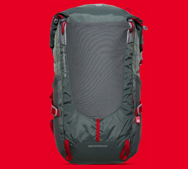 grey backpack on red colored background