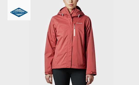 A woman in a red Cabot Trail jacket. Omni-Tech logo.