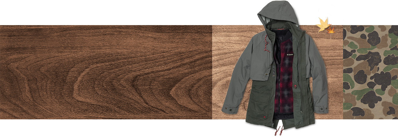 A jacket on a wood grain background with fall leaves.