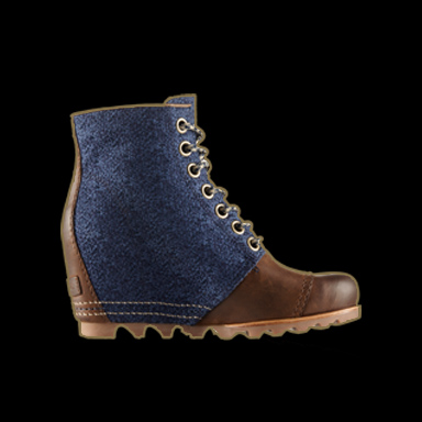 Blue and brown wedge boot on black background.
