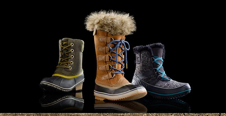 Three winter boots on a black background.