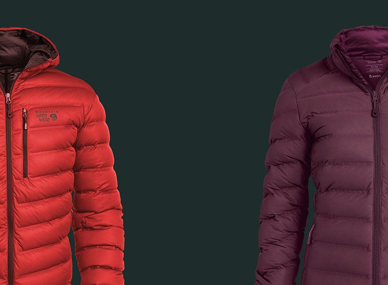 Men's red StretchDown jacket and a women's purple Stretchdown jacket on a grey background.